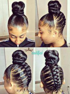 Sleek and braided hair with a bun