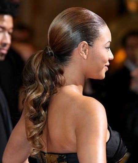 Low ponytail - sleek low ponytails with waves