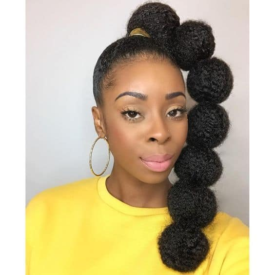 black weave ponytail - afro puff ponytail style