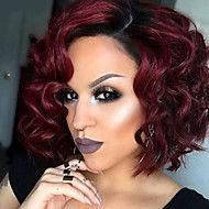 Curly red bob with dark roots