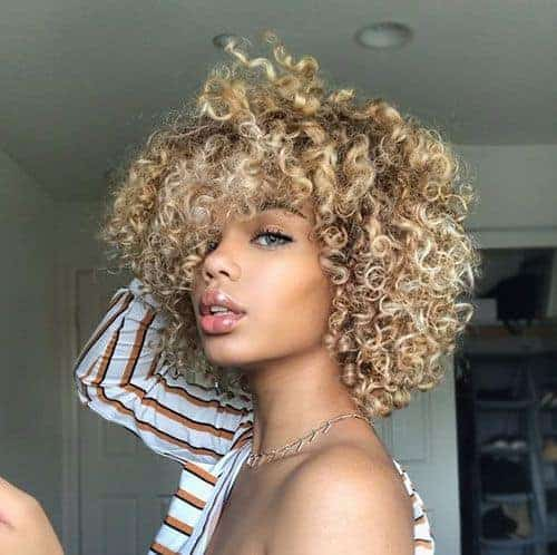 Short kinky curly hair with bangs